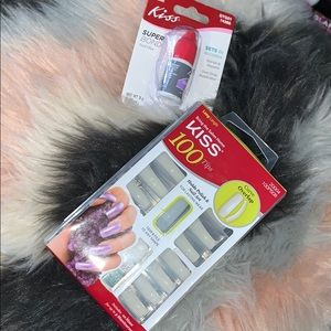 Acrylic nail kit with extra nail adhesive